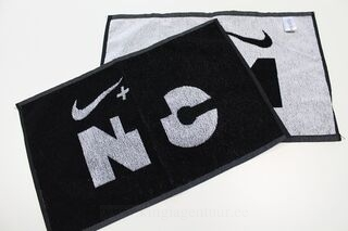 Towel with woven logo
